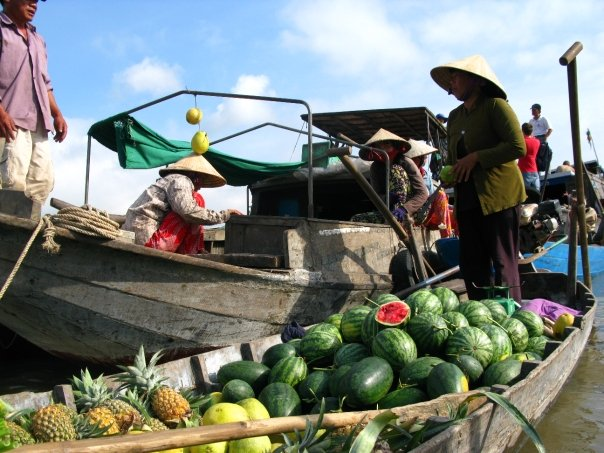 Visiting a floating food market in Vietnam's Mekong Delta.