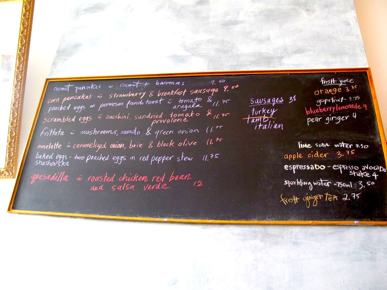 Saving Grace features its daily brunch specials on a chalk board  in the dining room.