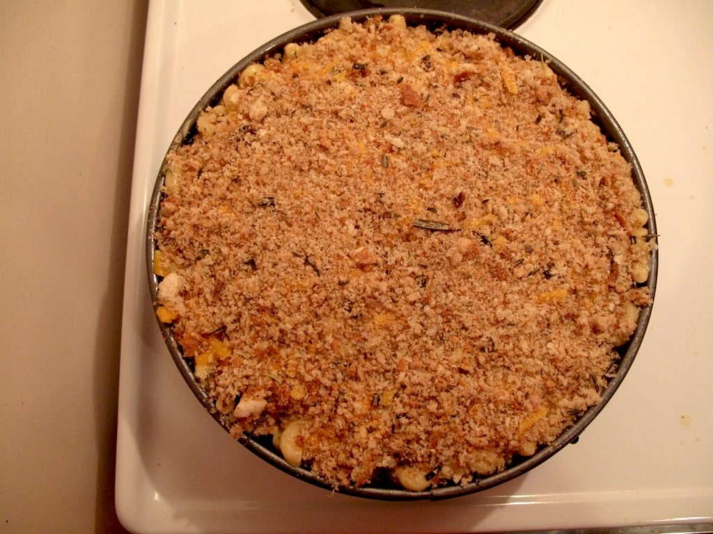 Top pulled pork mac and cheese with breadcrumbs.