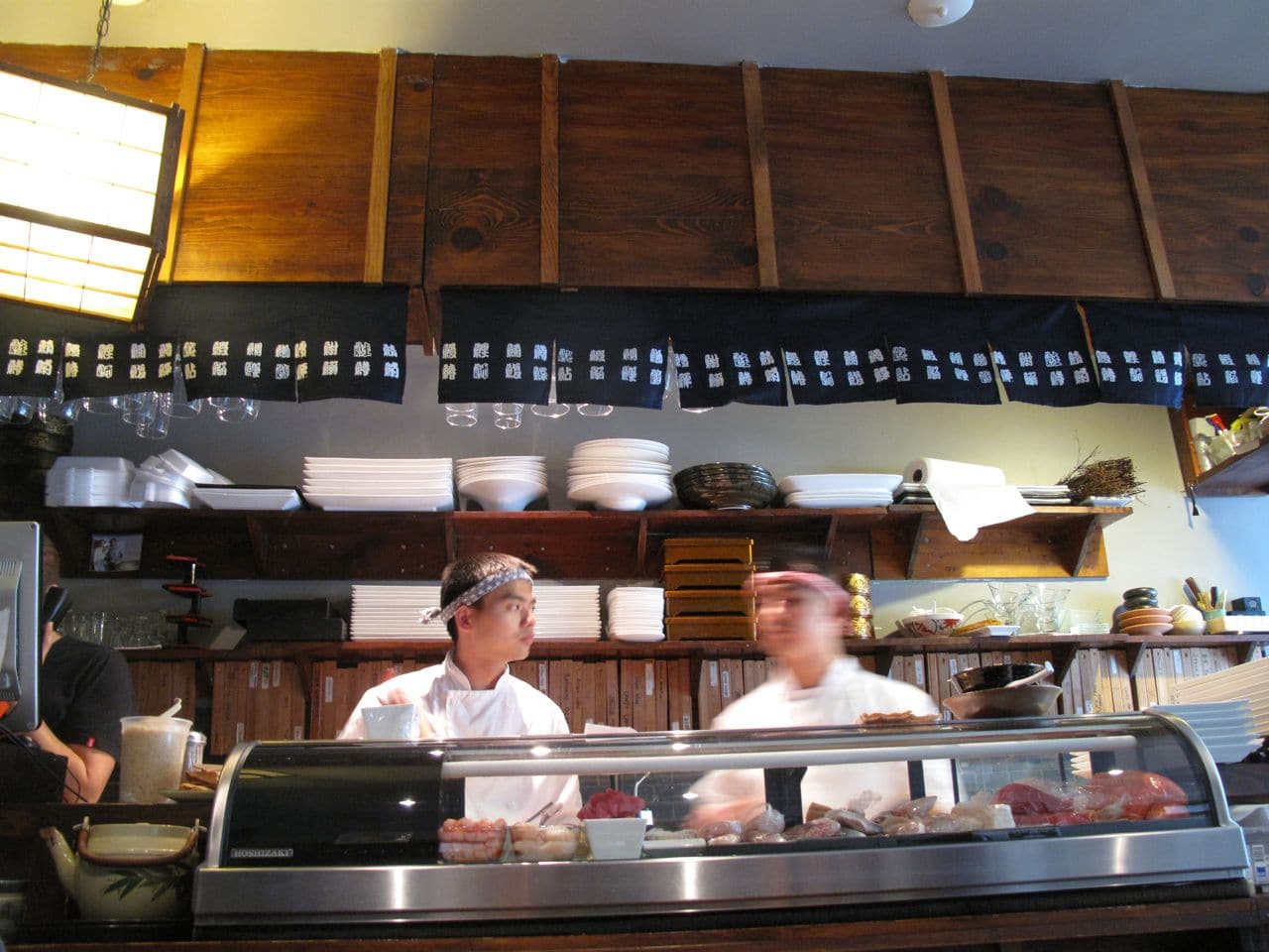 Sushi chefs prepare classic Japanese dishes at Japango Toronto.