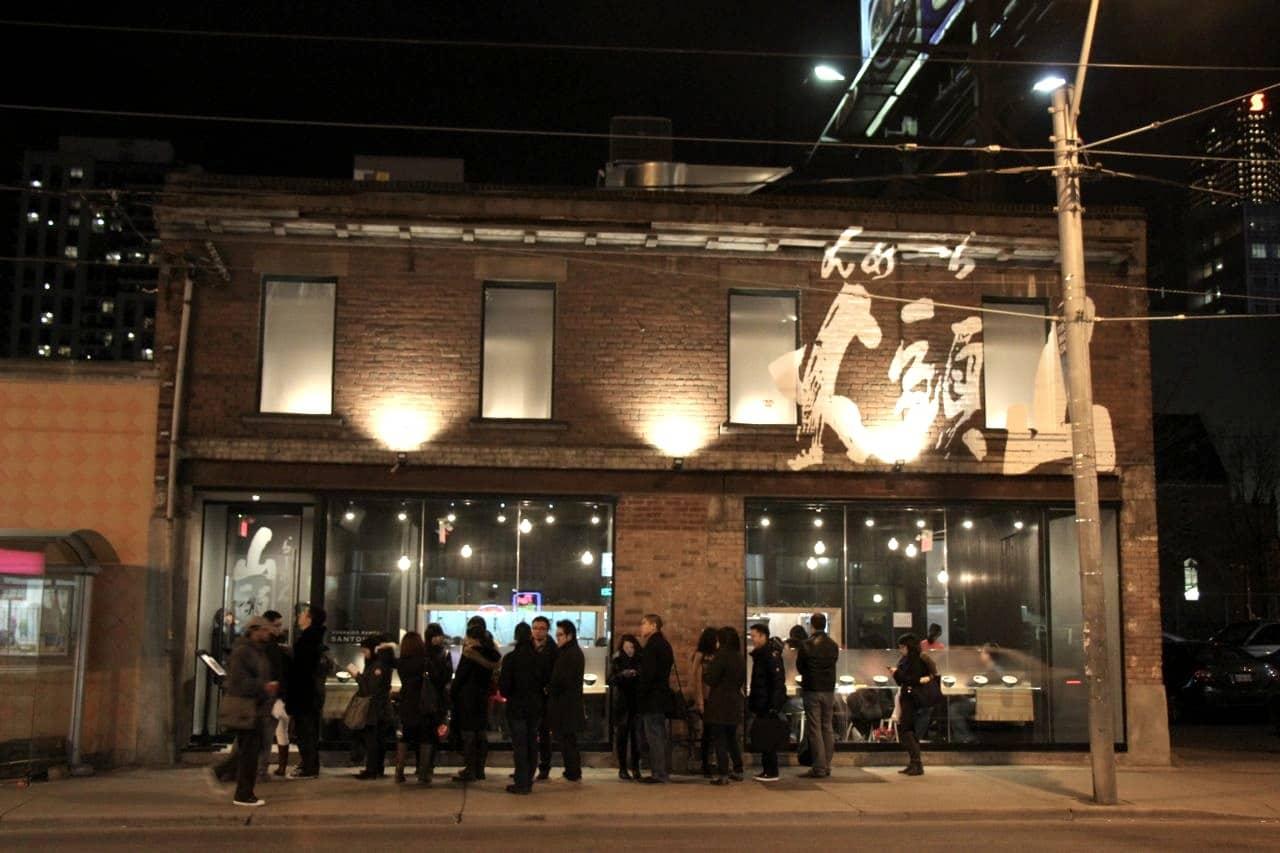 Ramen lovers line up down Dundas Street East for Santouka Ramen Toronto.