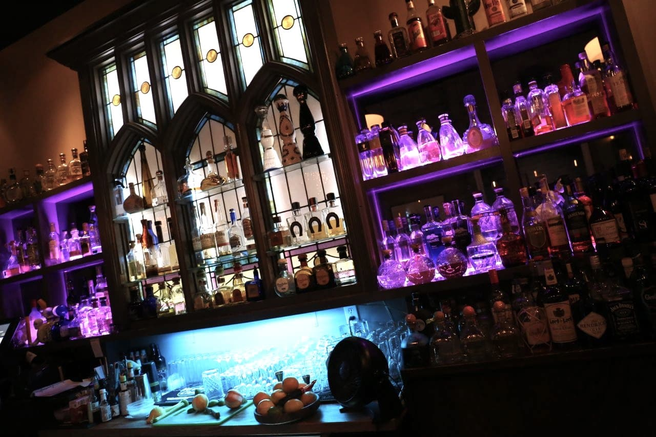 Premium tequila bottles line the back bar at Reposado Toronto.