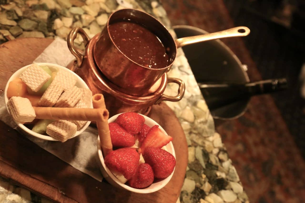 Finish your romantic dinner at Grizzly House Banff with a Toblerone chocolate fondue.