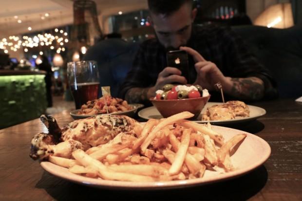 Famous roast chicken with peri peri fries at Nando's Toronto.
