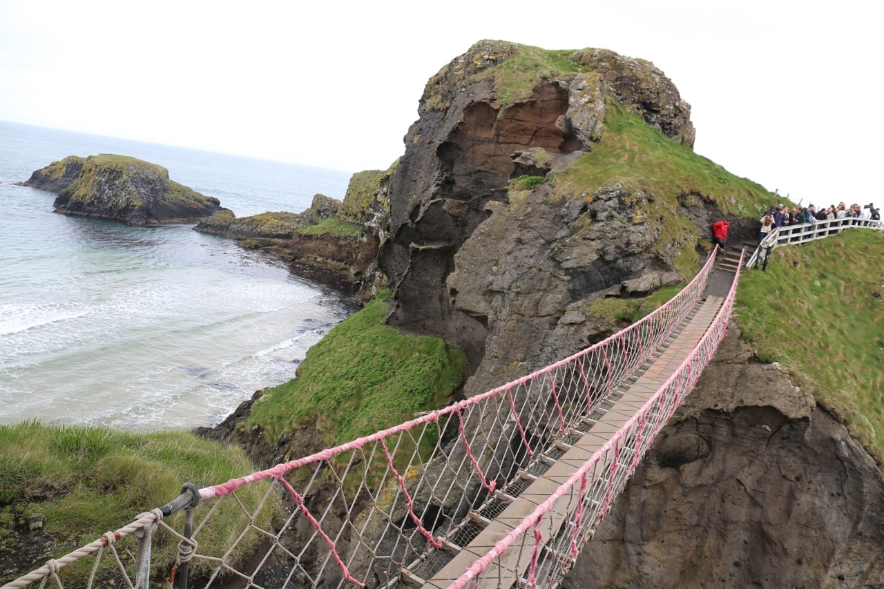 Ireland Road Trip: Conquer your fear of heights while skipping across Carrick-a-Rede Rope Bridge.