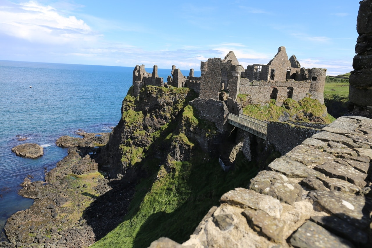 Ireland Road Trip: Enjoy scenic views while strolling through the ruins of Dunluce Castle.