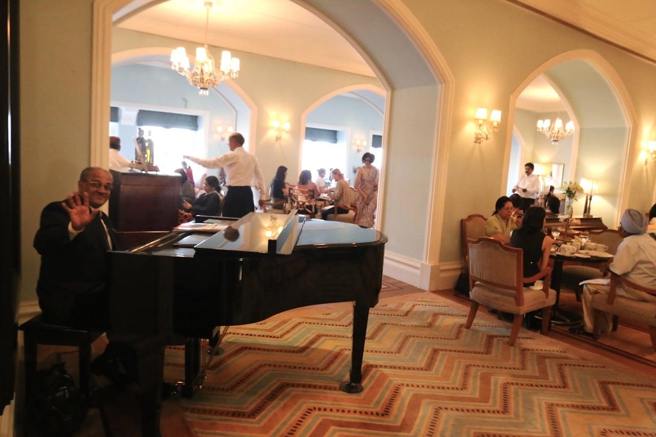 Pianist plays on a grand piano at Taj Mahal Palace Hotel Mumbai's High Tea.