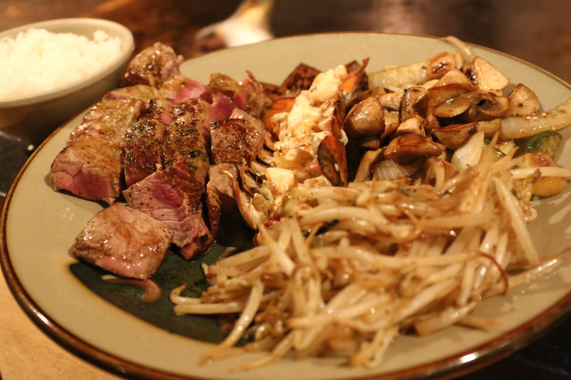 Chateaubriand steak with lobster tail,hibachi grilled onion, zucchini & mushrooms at Benihana