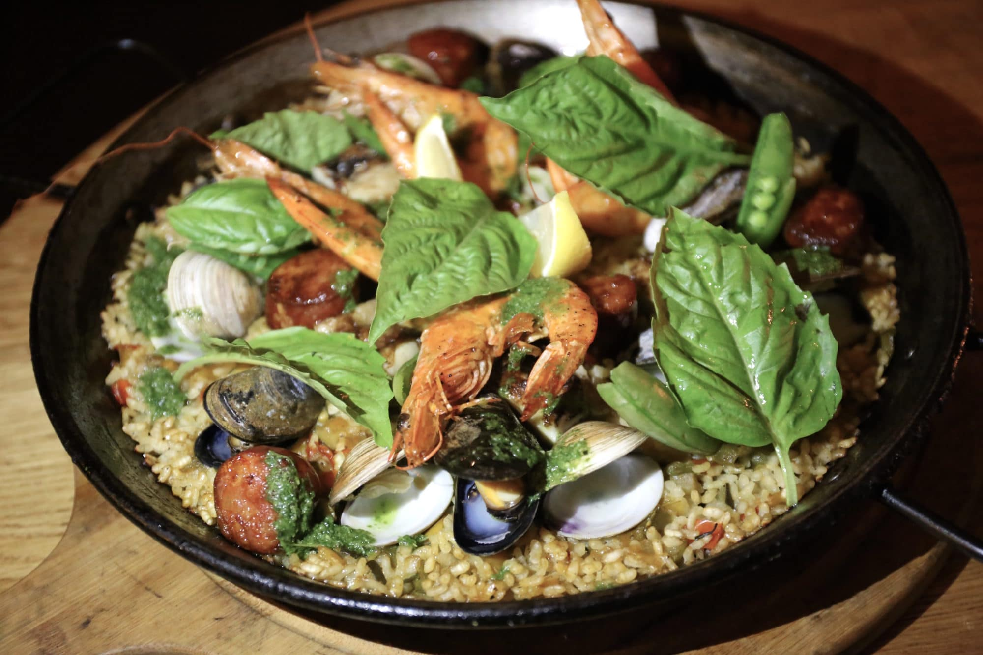 Shrimp, clams, mussels, chorizo, chicken and saffron in Carmen Toronto's signature paella.