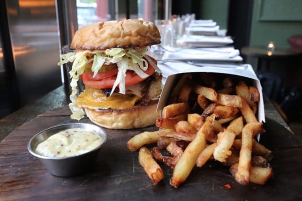 A fully loaded Cheeseburger at The Good Son restaurant.