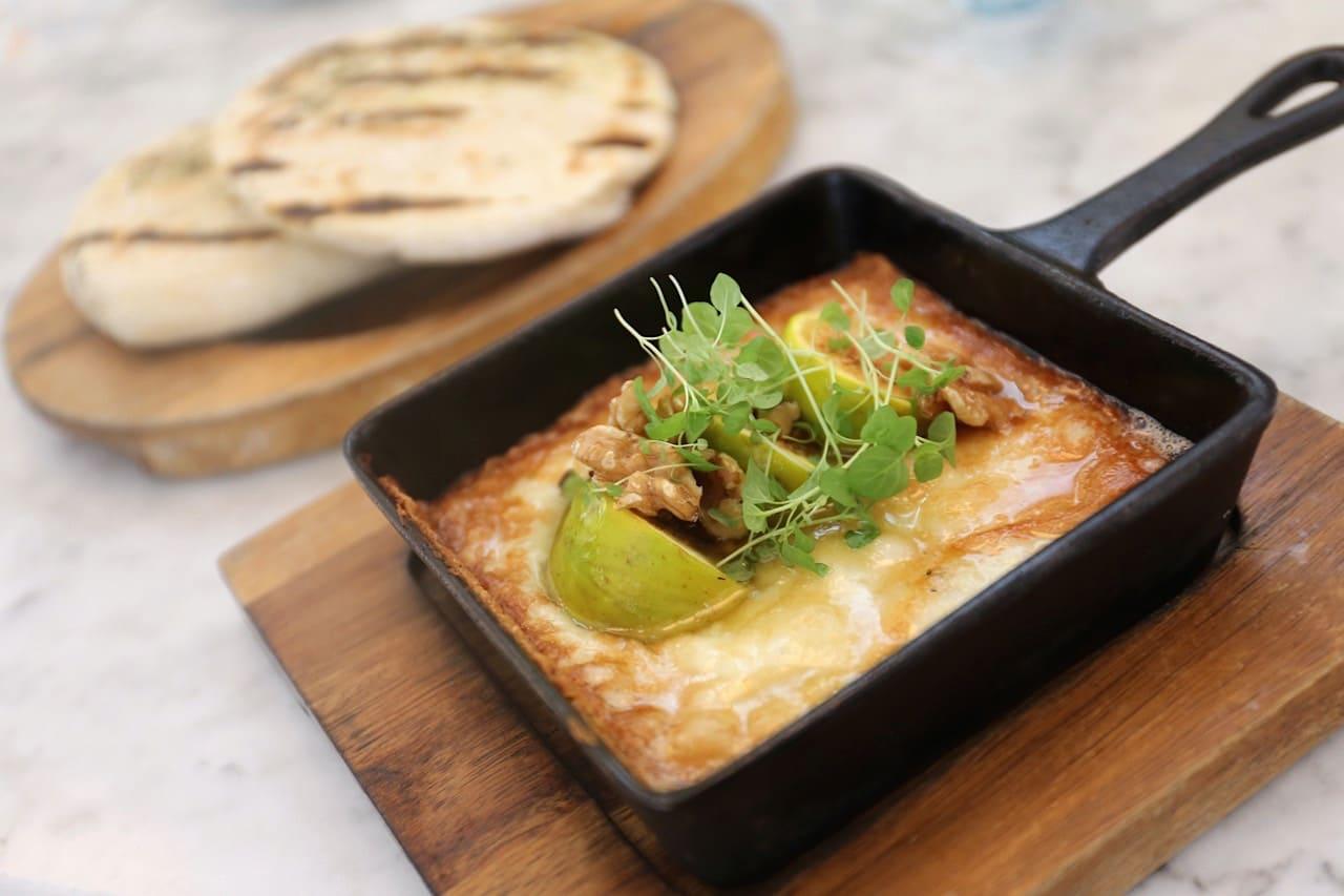 Greek Cheese Saganaki with fresh figs and honey at Mamakas Taverna.