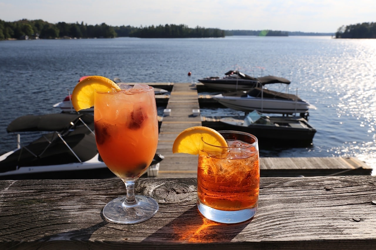 Sip summer cocktails at Taboo Resort's lakeside bar.