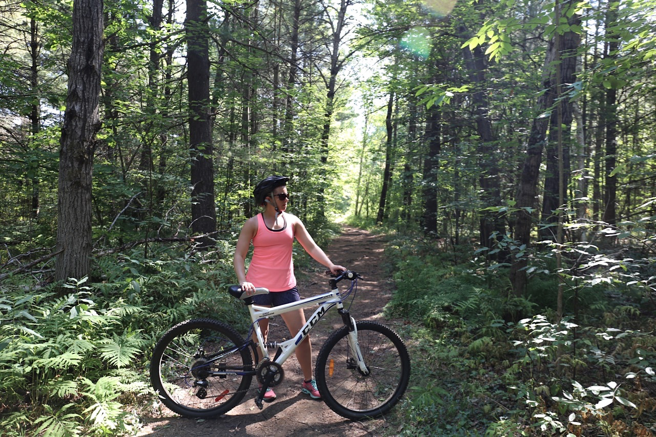 Peddle a mountain bike through nearby forest trails.