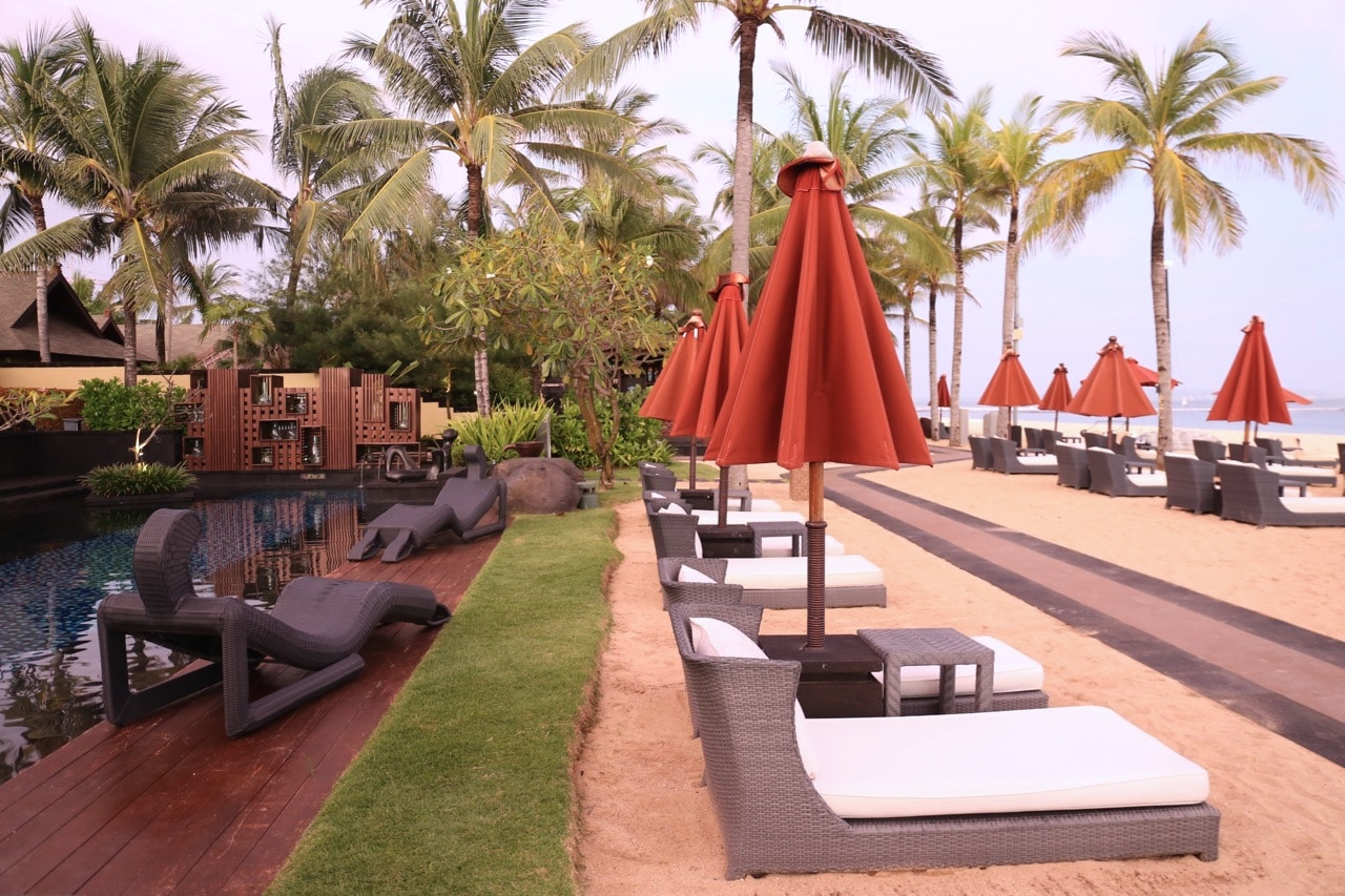 Modern beach furniture line the beach in Nusa Dua.