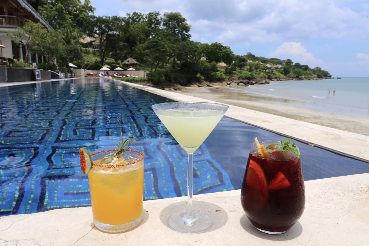 Swim in an infinity pool while sipping craft cocktails at Four Seasons Jimbaran Bay.