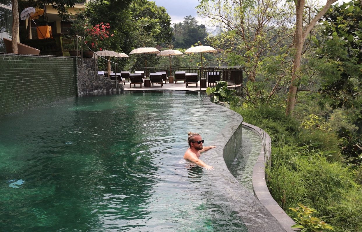 Komaneka Tanggayuda is a luxury boutique hotel with scenic infinity pool nestled in Ubud's jungle.