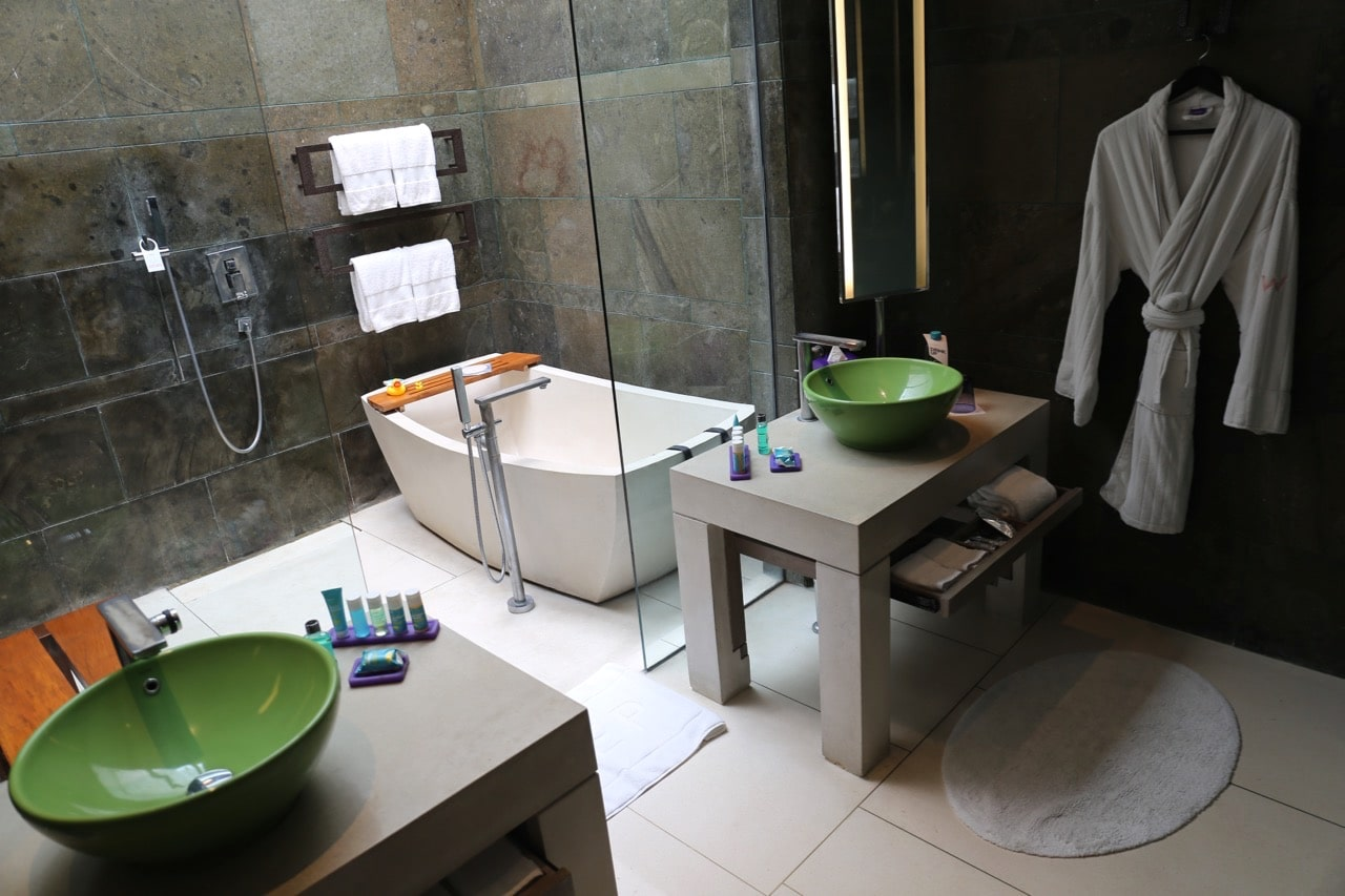 A luxurious bathroom interior is found within one of W Bali's modern suites.