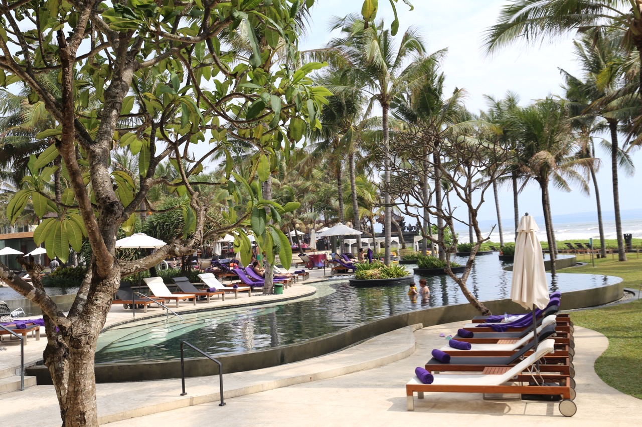 Relax at the W Bali's lagoon-style pools with views over Seminyak Beach.