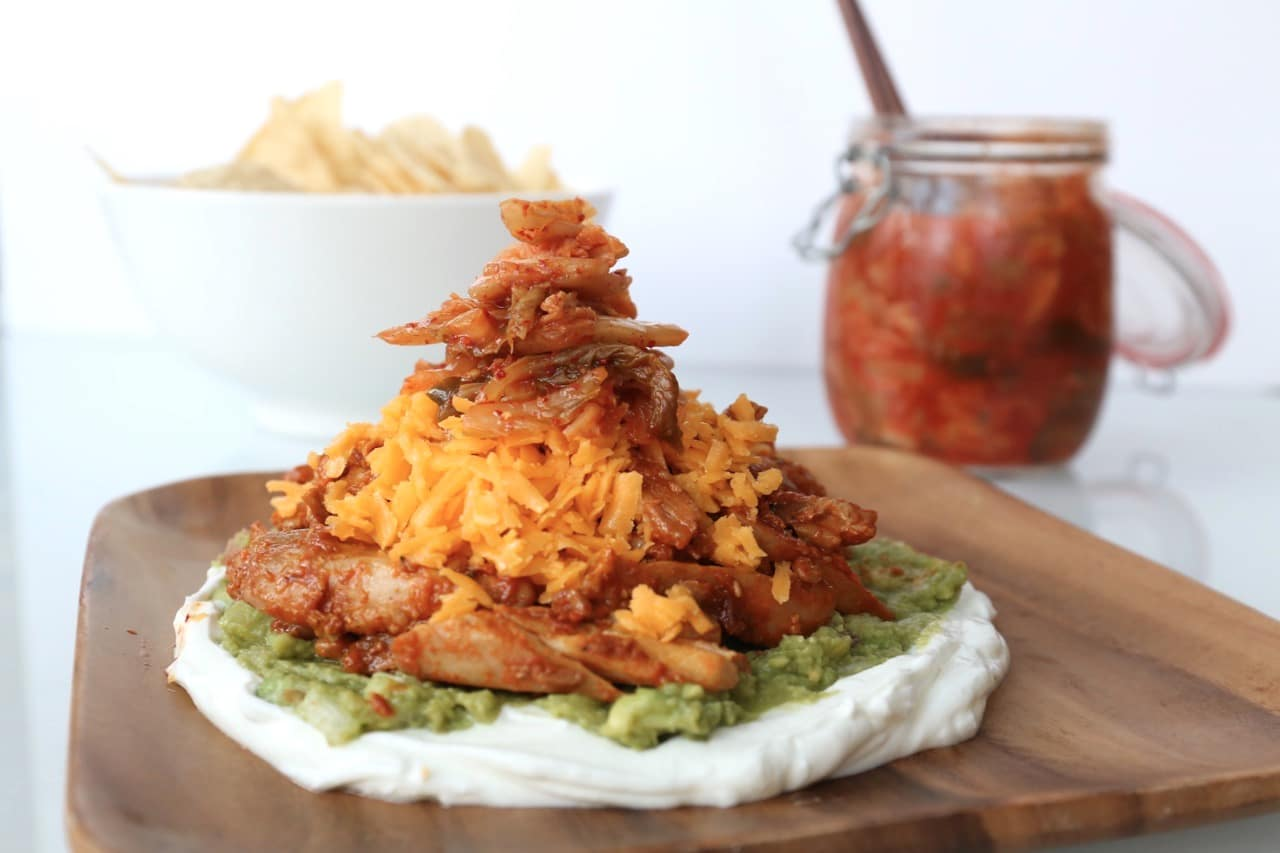Korean Ssamjang Chicken served with sour cream, guacamole,  cheddar and kimchi.