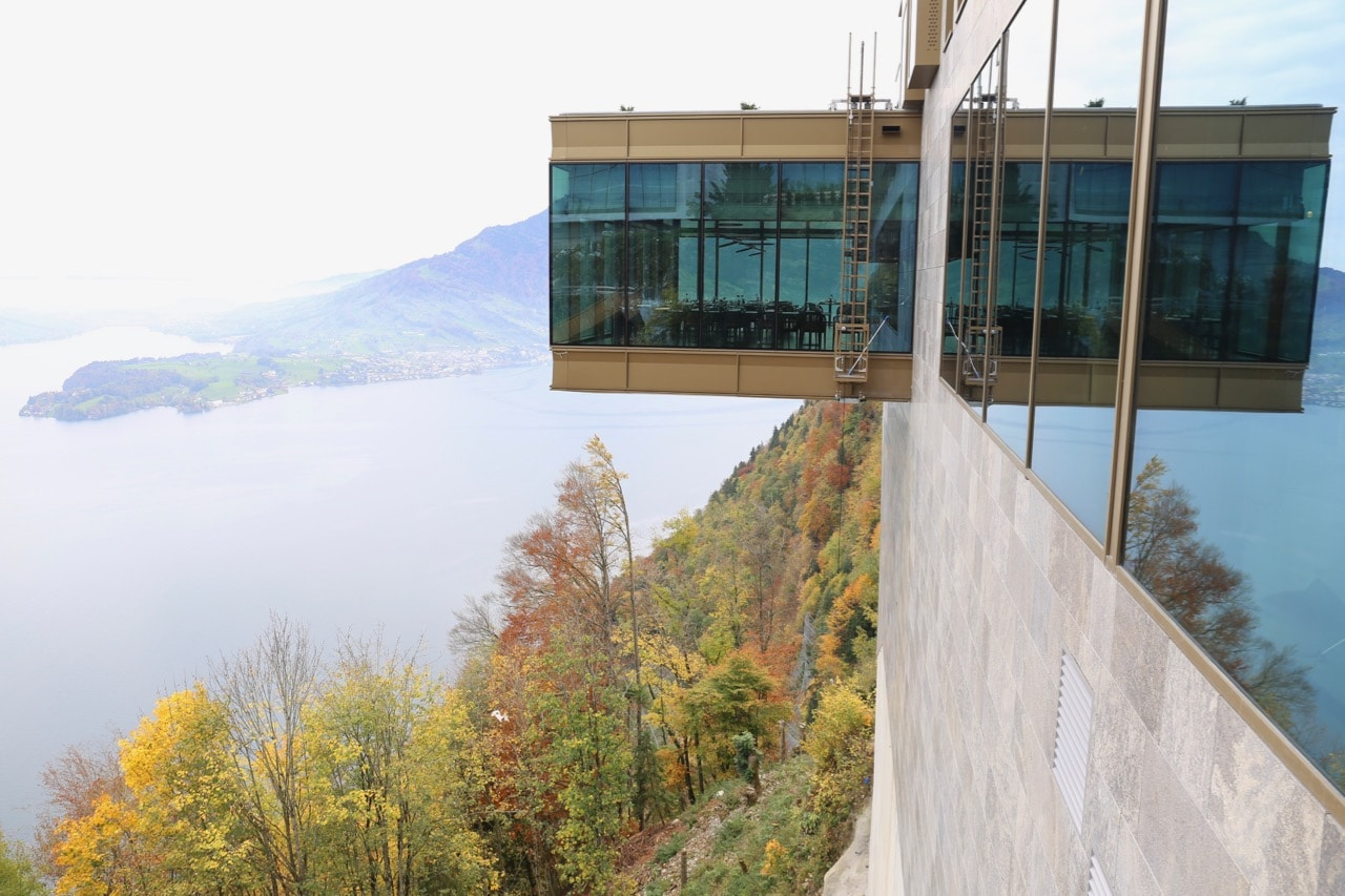 The dining room at Spices Kitchen hangs over a cliff at Burgenstock Resort.