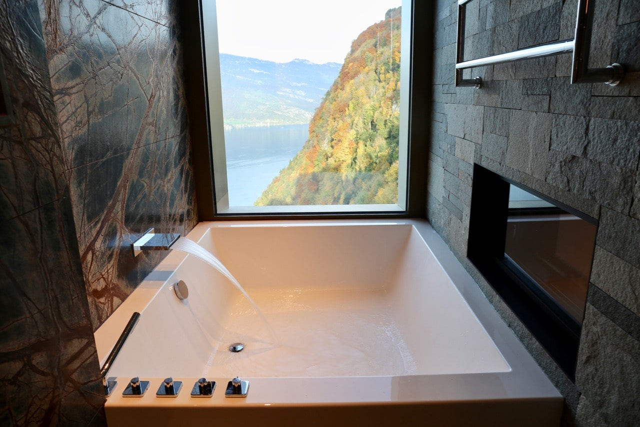 Start a romantic couples getaway by soaking in an oversized bath with a view.