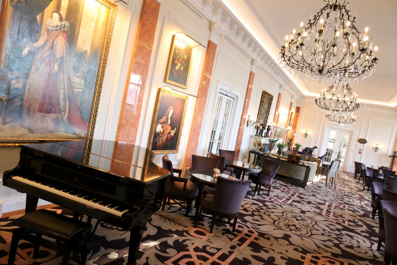 The hotel's interior is decorated with crystal chandeliers, fine art and grand piano.