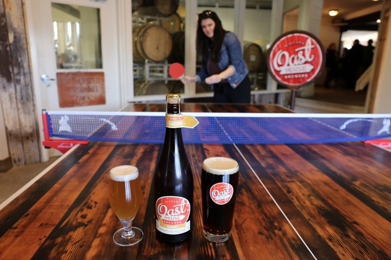 Avoid the cold with a craft beer while playing ping pong at Oast House Brewers.