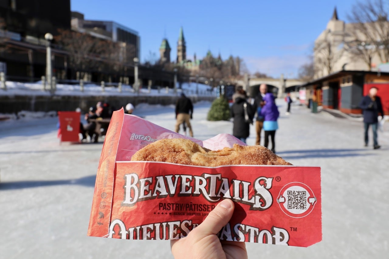 Enjoying a BeaverTail while skating on Ottawa's Rideau Canal.