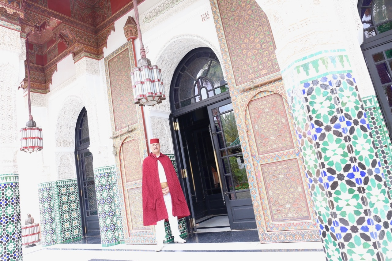 Guests are greeted at La Mamounia's front entrance by dapper doormen who wear eye-catching rich rouge capes.