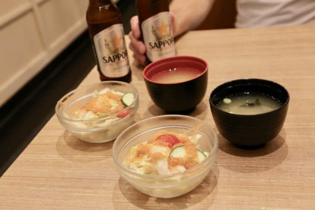 House salad, miso soup and Sapporo beer at Kaka All You Can Eat Sushi Toronto.