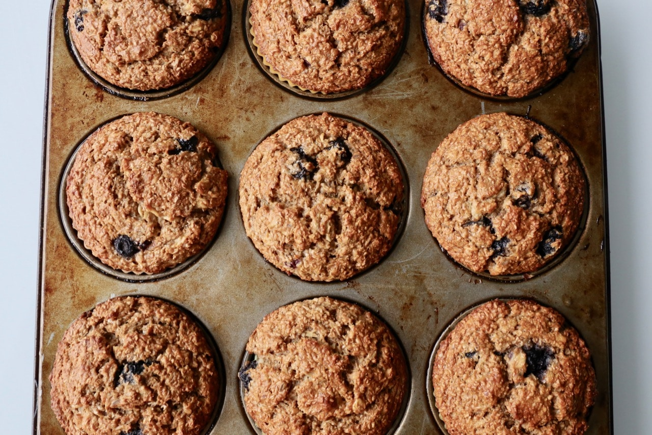 Blueberry Banana Muffins fresh out of the oven make a great High Fiber Breakfast.