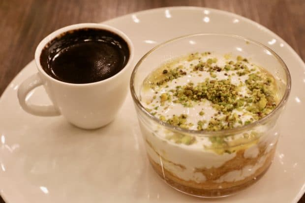 Kunafa with cream and pistachio served with Turkish coffee.