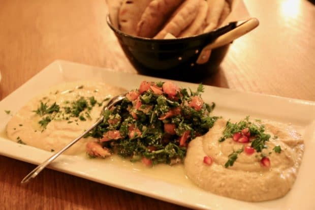 Hummus, babaganuj, and tabule served with warm pita.