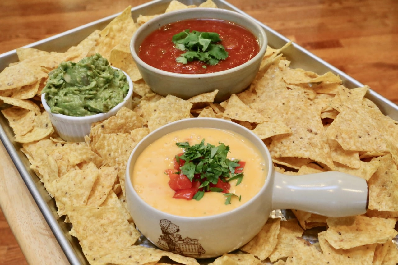 Classic Velveeta Cheese Dip served with nachos, salsa and guacamole.