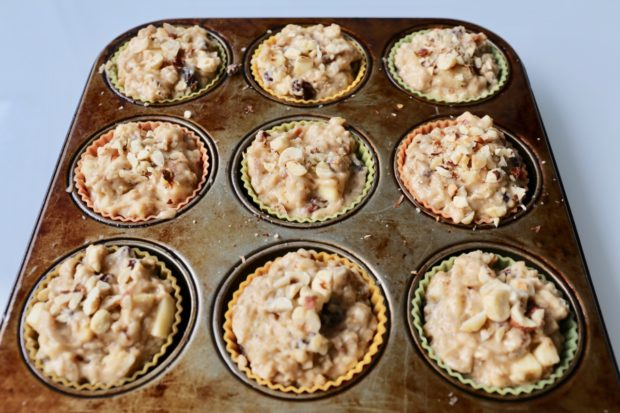 Mincemeat Muffins topped with chopped hazelnuts are ready to go into the oven.