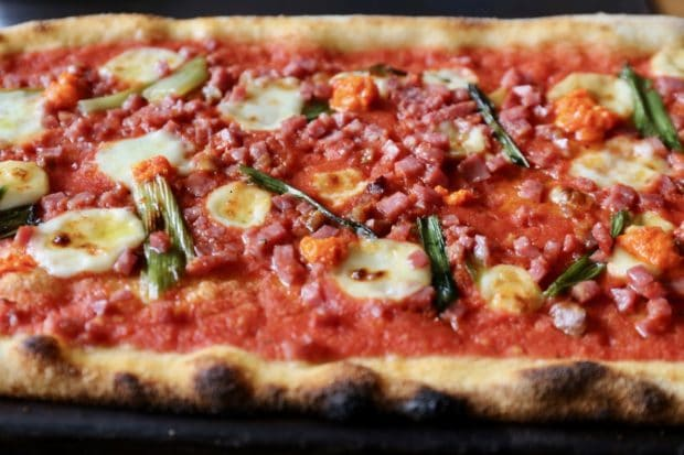 Buca offers slender thin-crust pizza for delivery in downtown Toronto.