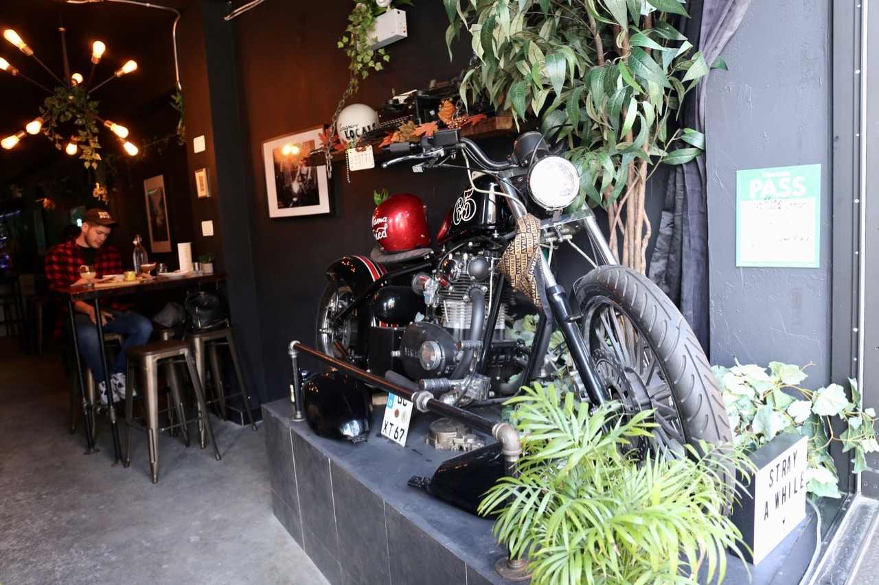 A motorcycle at the entrance of Bar Stray on College Street.