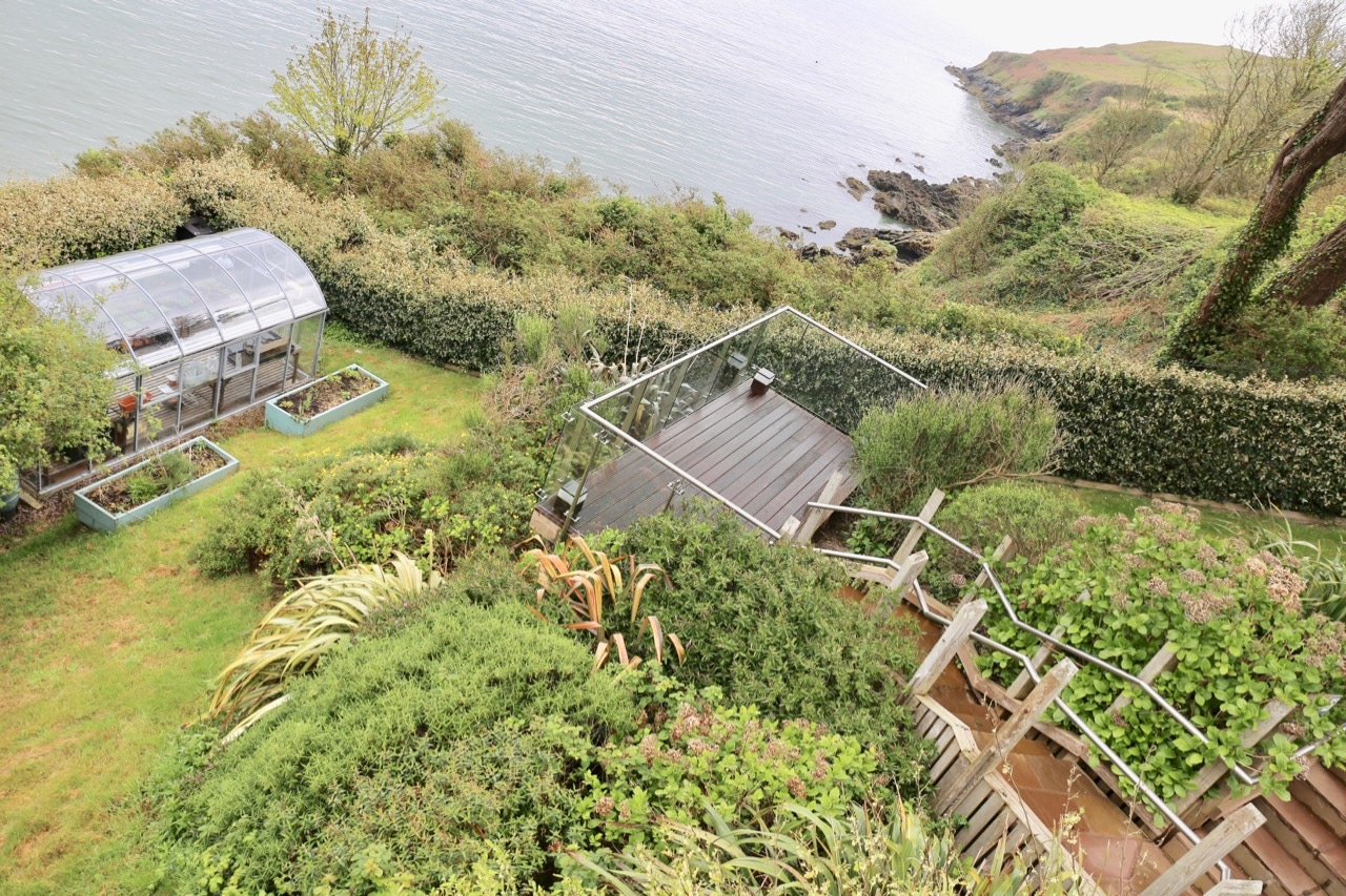 The organic garden and greenhouse at Cliff House Ardmore.