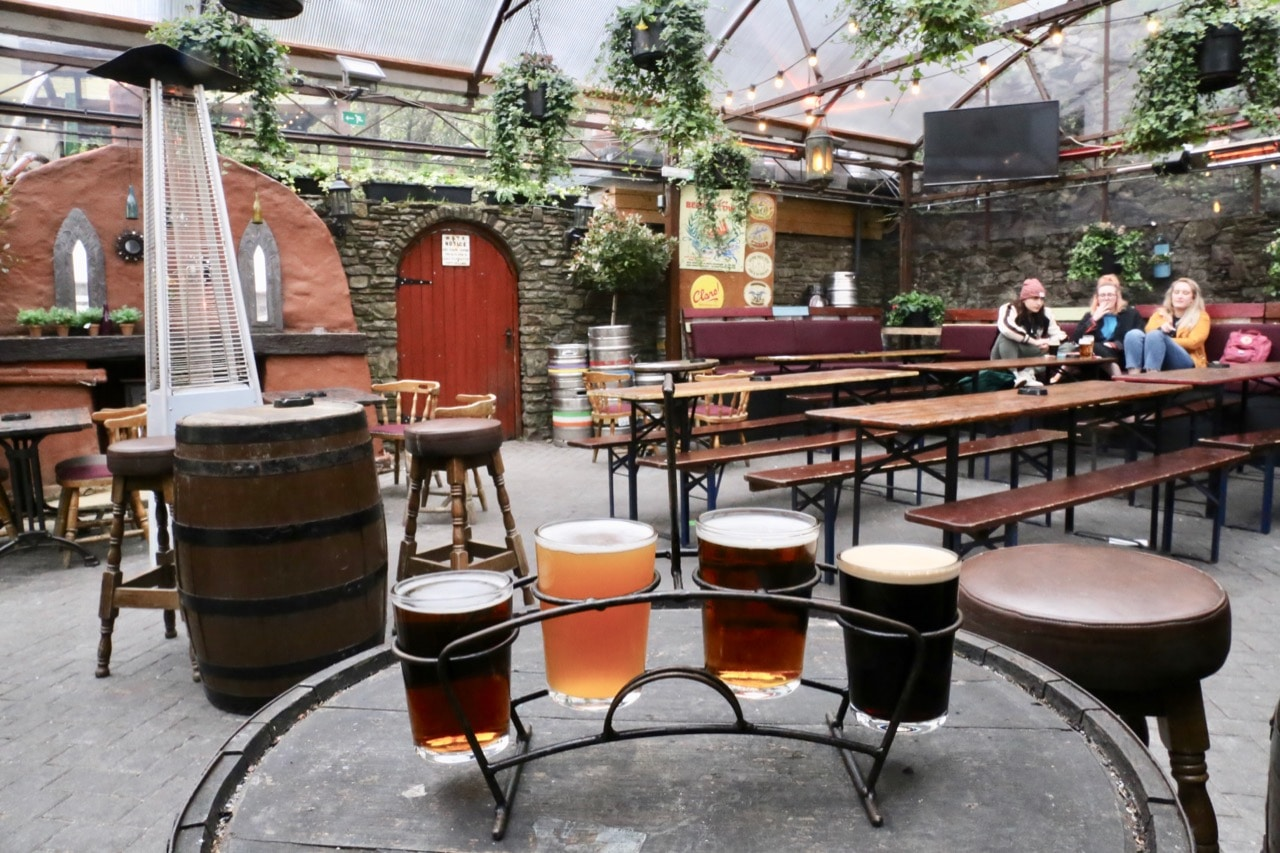 Things to do in Cork: Enjoy a pizza party with craft beer on the backyard patio at Franciscan Well Brewery.