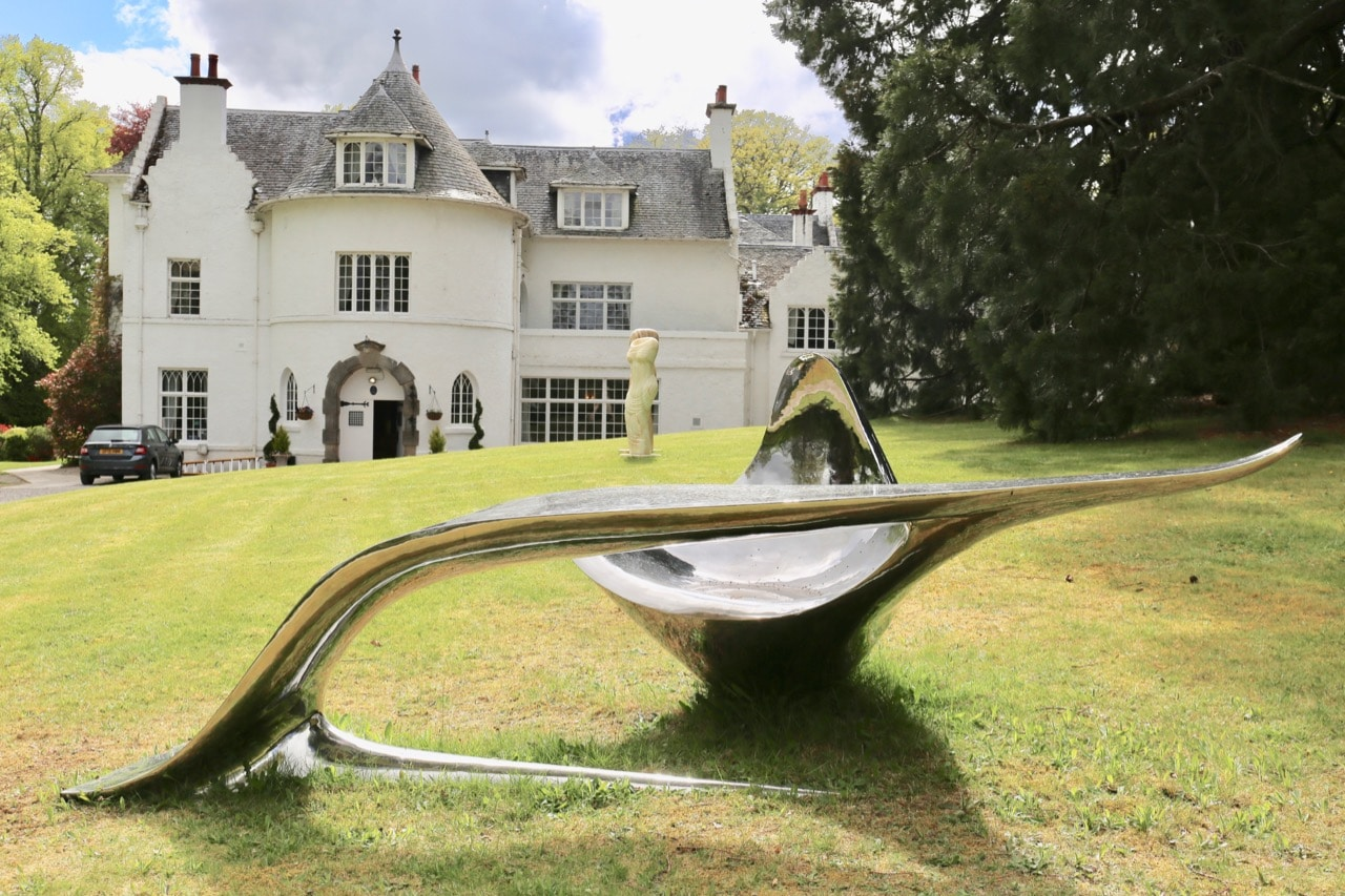 Achnagairn Castle's gorgeous estate is decorated in contemporary art and sculptures.
