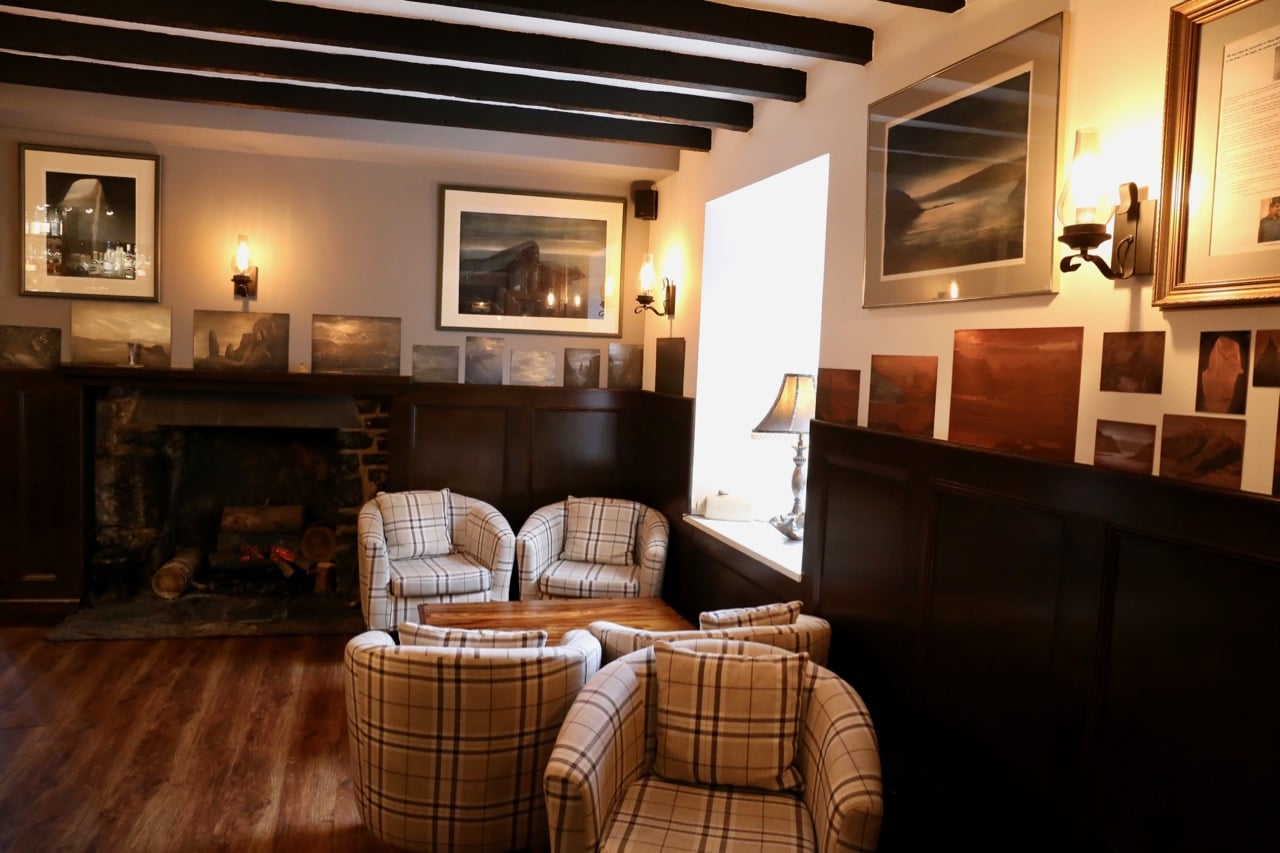 The cozy bar at Edinbane Lodge features a booming fireplace.