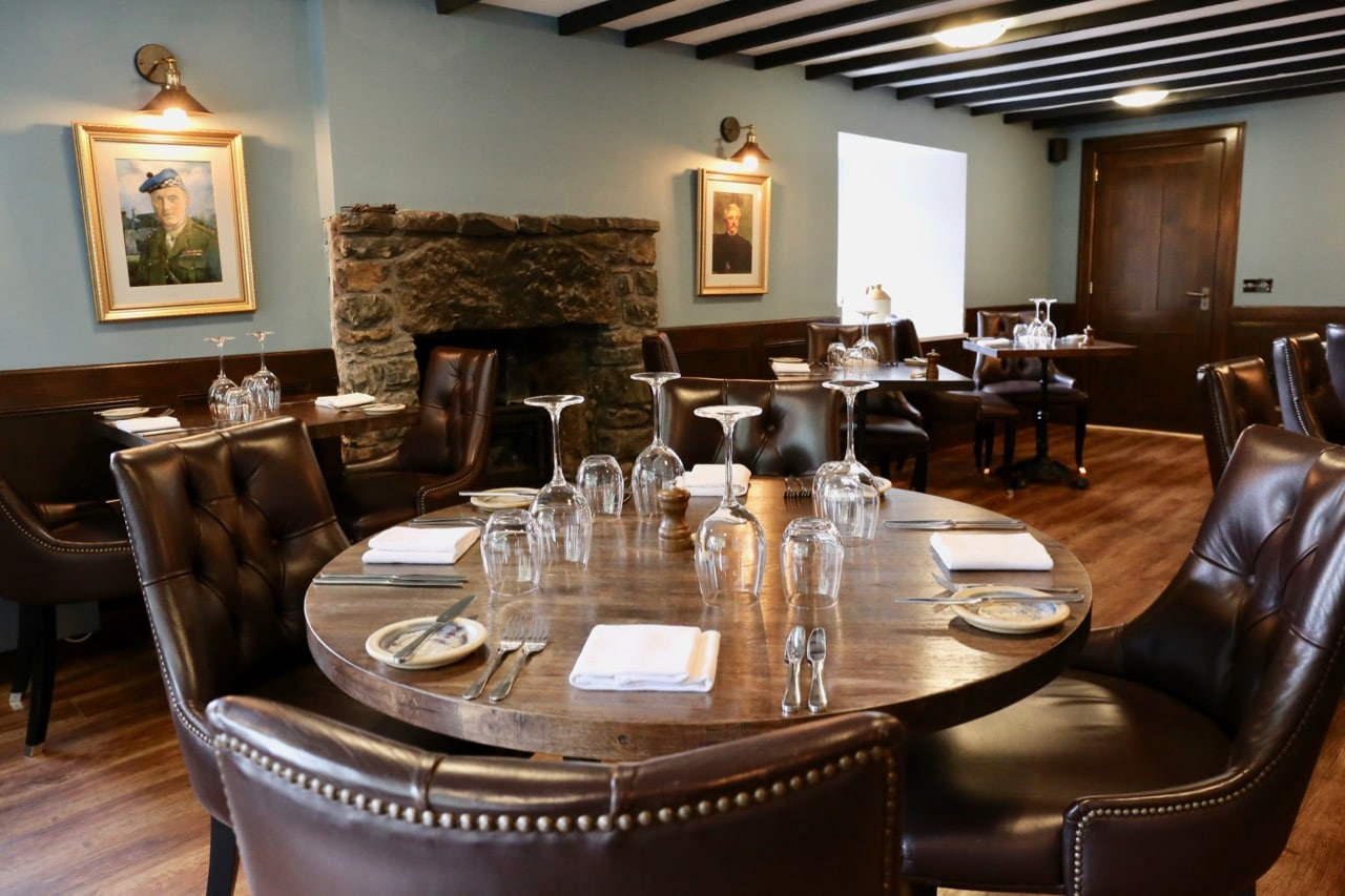Leather, stone and hardwood decorate the dining room at Edinbane Lodge's restaurant.