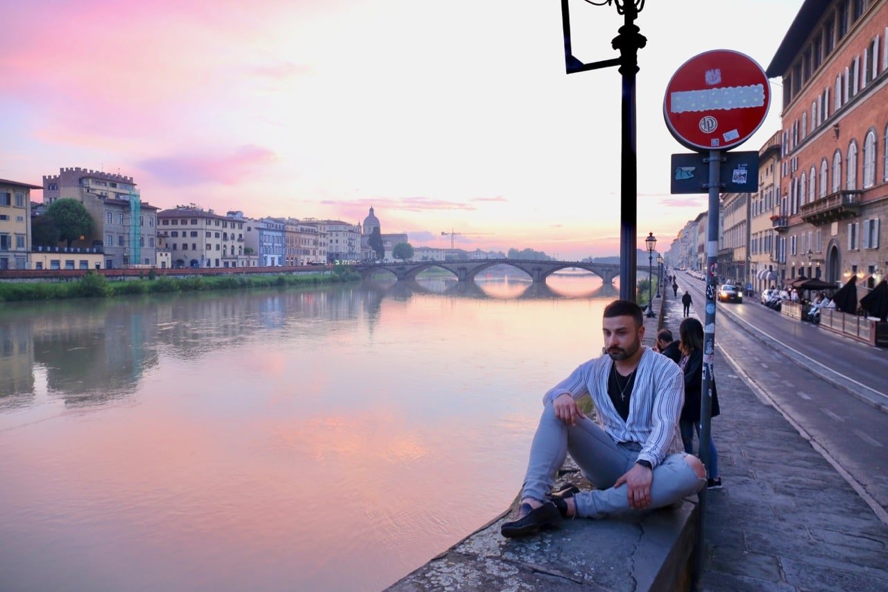 Enjoy a romantic sunset stroll along the Arno River.
