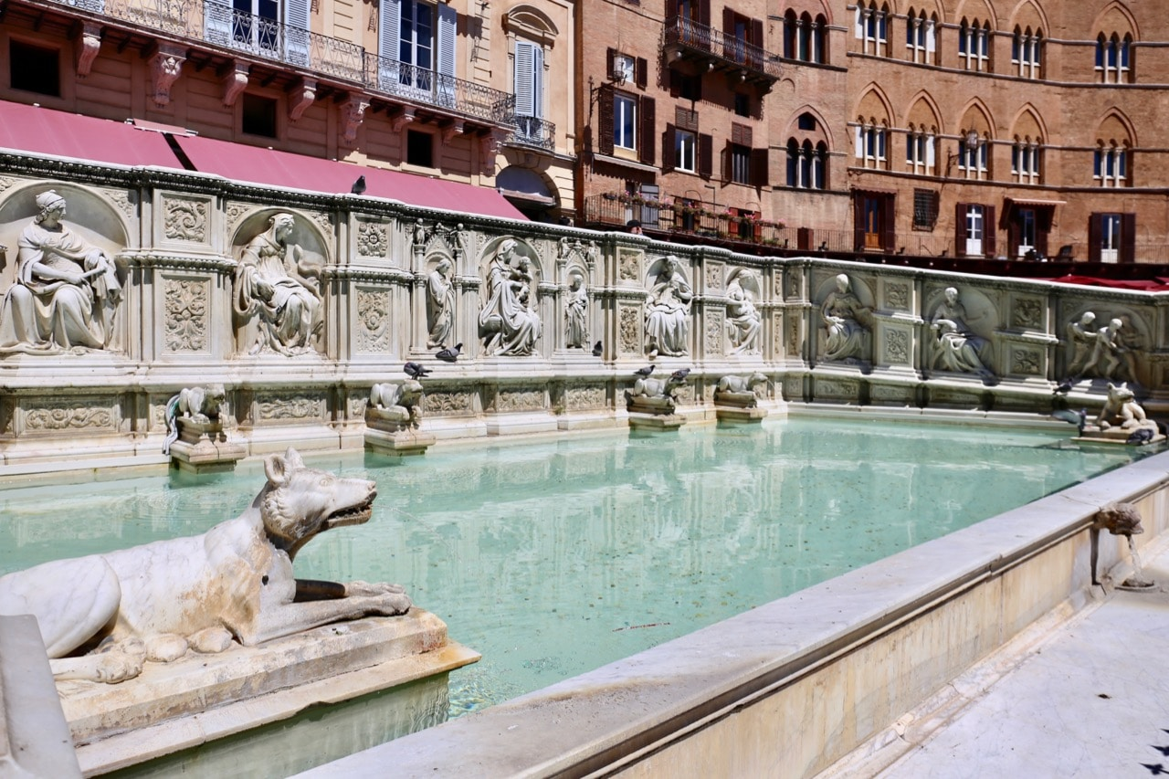Enjoy a refreshing splash in Gaia Fountain at Piazza del Campo.