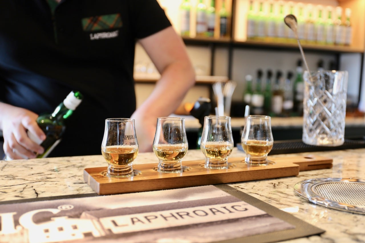 Enjoy a single malt whisky tasting at Laphroaig Distillery.