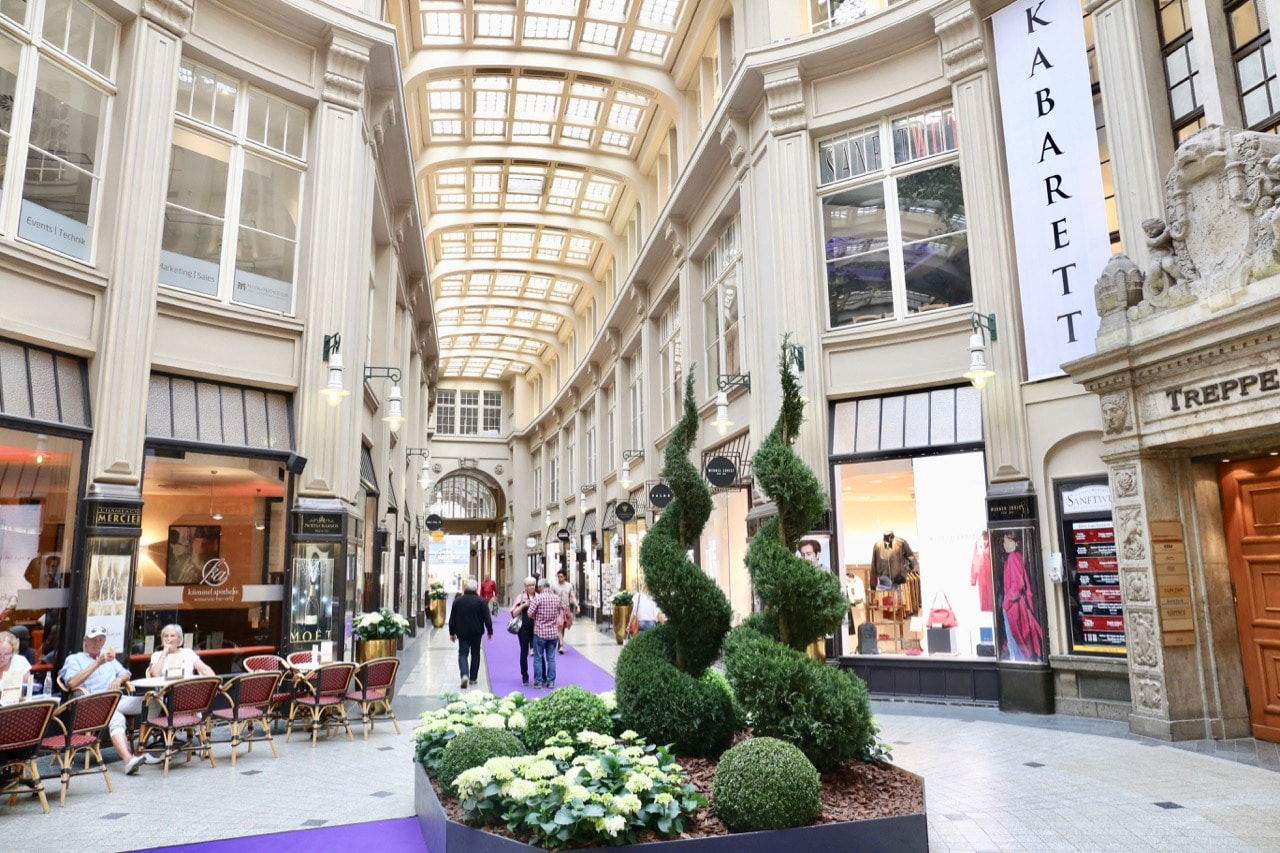 Fashionistas on a gay Leipzig getaway enjoy shopping at boutiques in The Madler Passage.