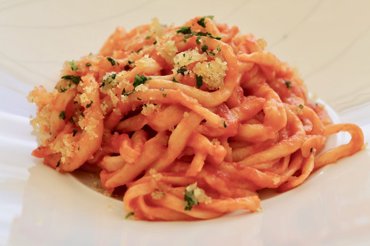 Learn how to make traditional Tuscan food like pici pasta in a cooking class.