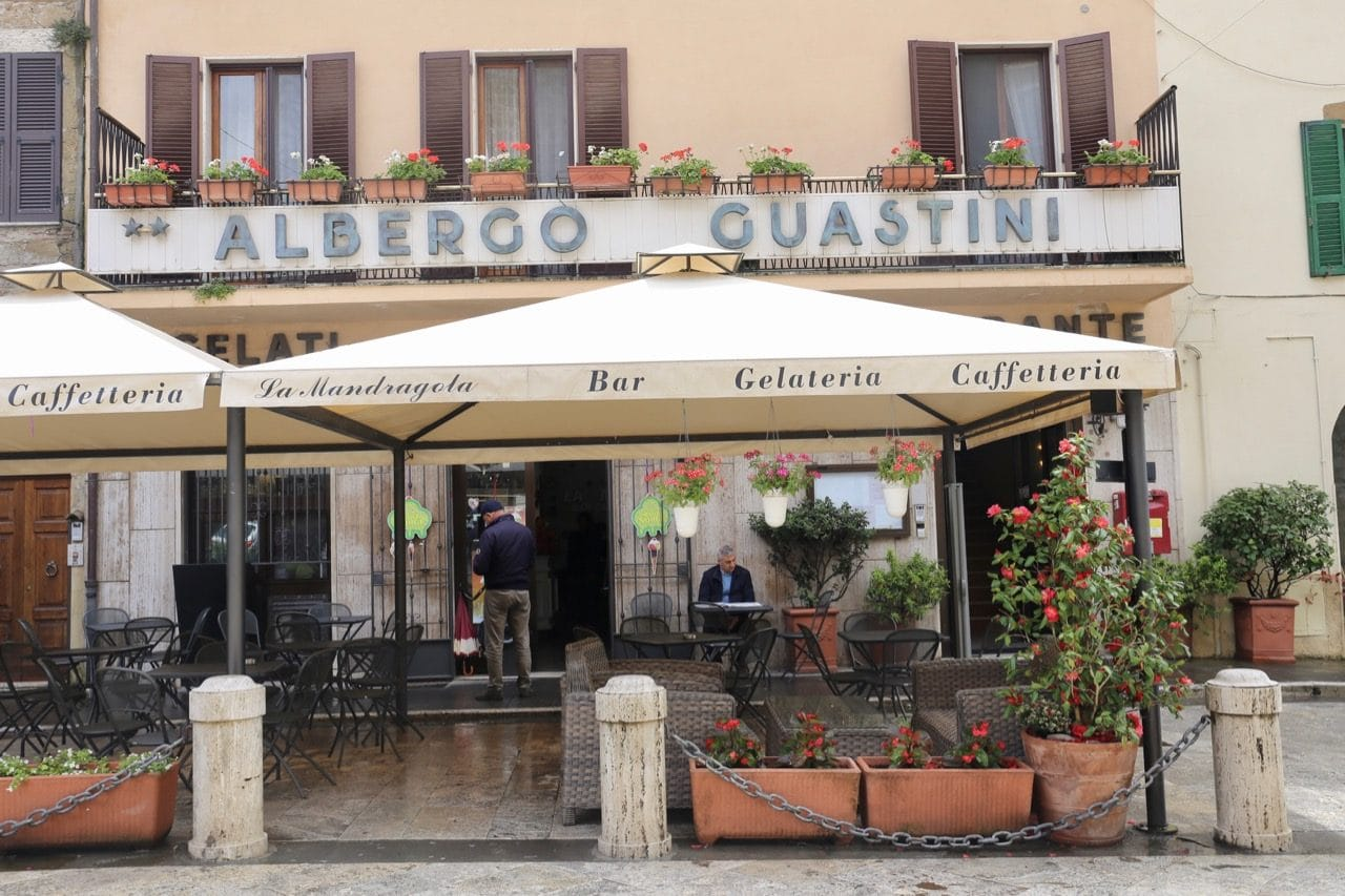 Albergo Guastini is located directly in front of the Tuscan village's main entrance gate.