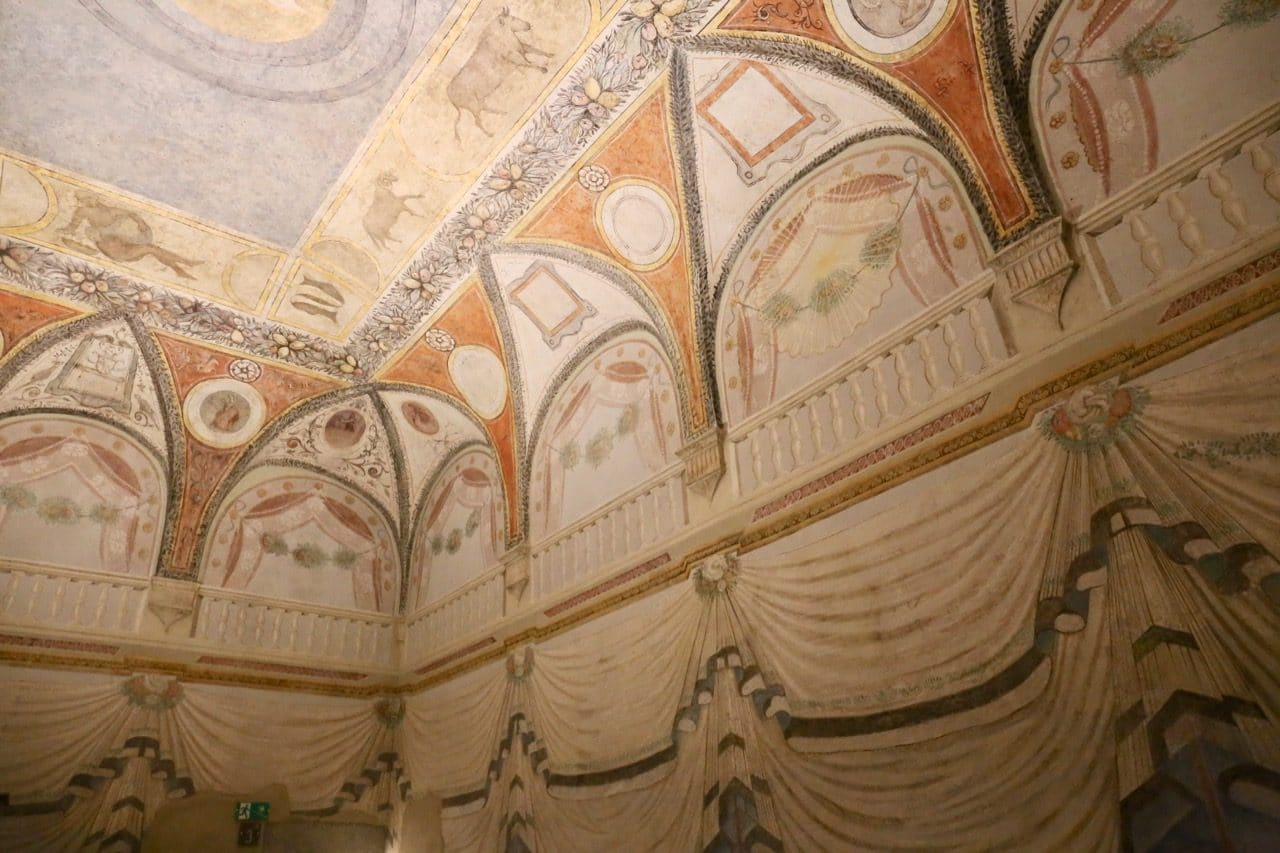 Detailed frescoes at the Museum of Palazzo Orsini in Pitigliano Italy.