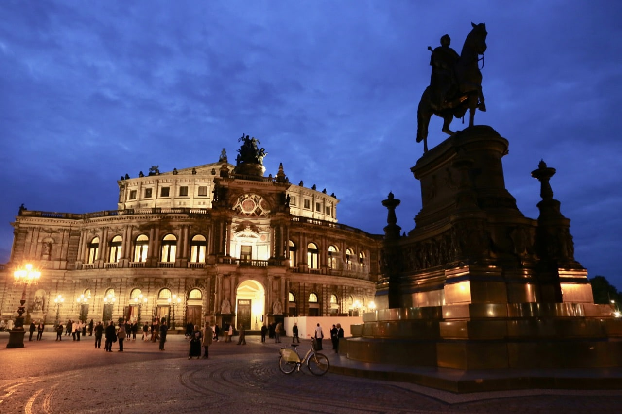 Enjoy a romantic walk at night by Semperoper, Dresden's opera house.